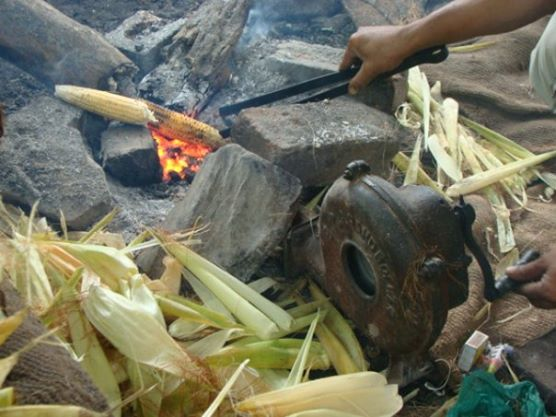 Locals using kinetic energy to cook corn!
